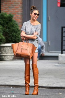 chrissy-teigen-street-style-gray-tee-denim-cut-off-shorts-knee-high-boots-celine-tote