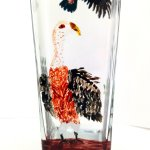 Bird glass painting on a vase with two vultures