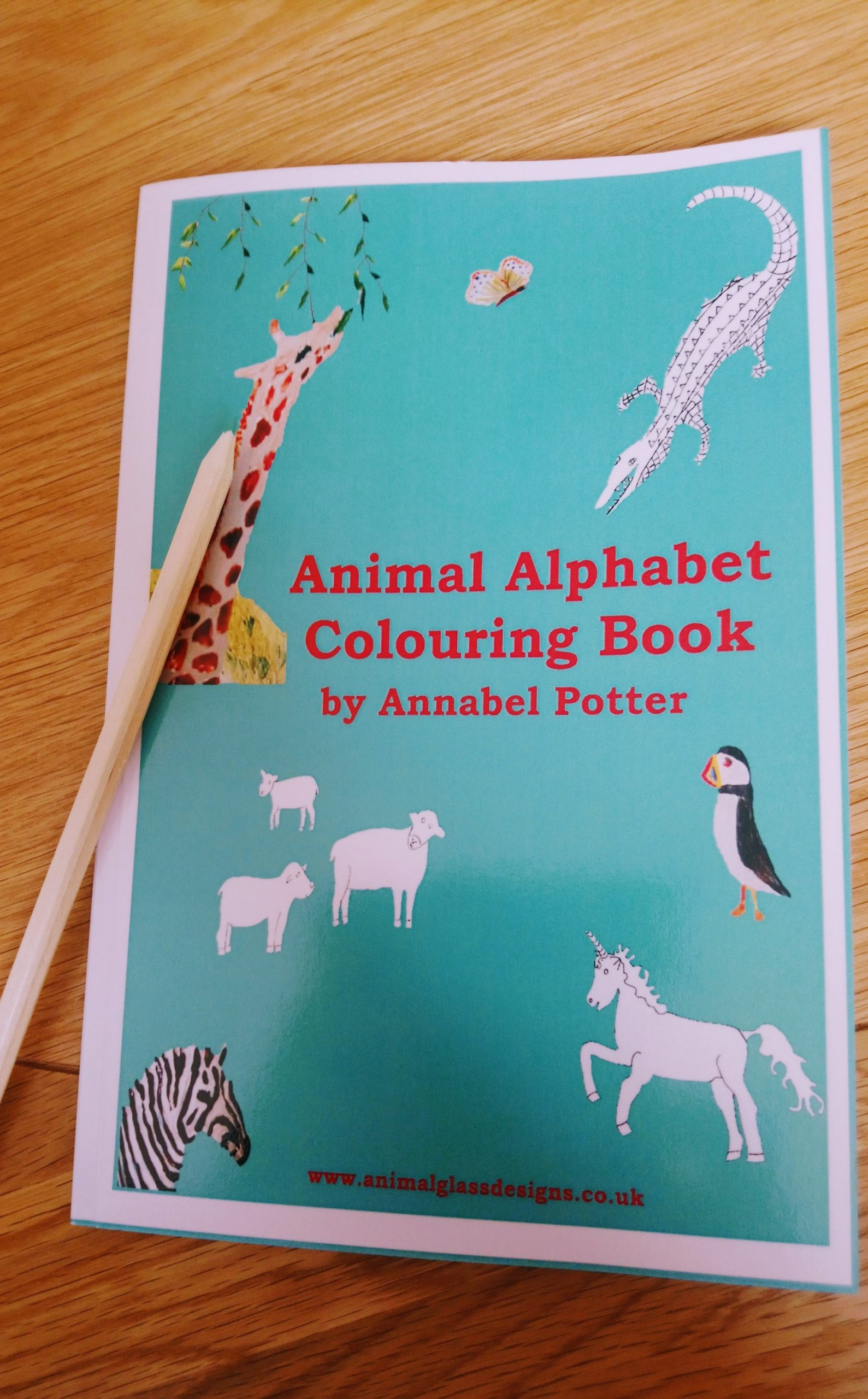 Picture of travel size animal alphabet colouring book with a pencil