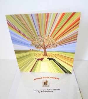 Dog card with Dachshund under an autumn tree and stripes radiating out.