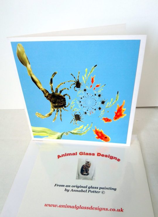 Greeting card with an abstract rock pool image with crabs and fish