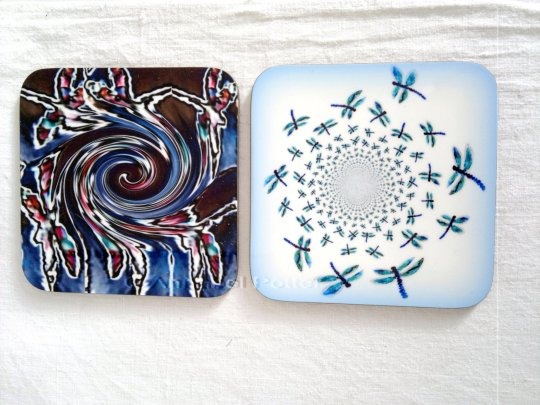 Two coasters with abstract dragonfly illustrations
