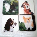 set of four dog coasters with an Old English Sheepdog, Terrier, Springer Spaniel, Corgi