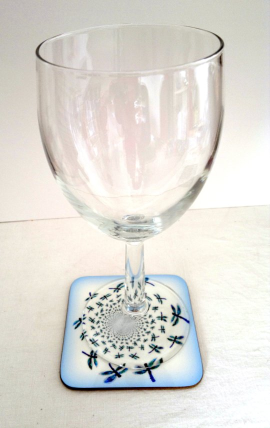 Coaster photo with abstract dragonflies and a wine glass