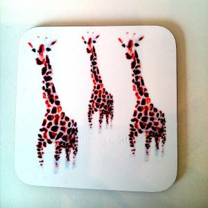 Coaster with an illustration of three giraffe