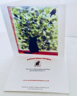 Greeting card with a black ct watching a blackbird in a bush