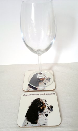 A photo of a black and white Springer Spaniel drinks coaster with a wine glass