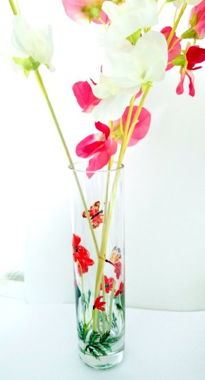 Bud vase painted with red poppies and two butterflies, shown with flowers