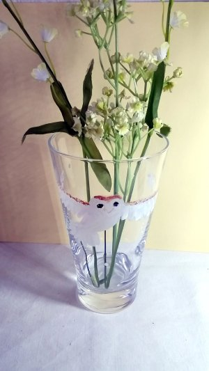 Barn owl vase photographed with flowers