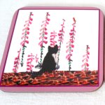 Foxglove flowers with a black and white cat coaster
