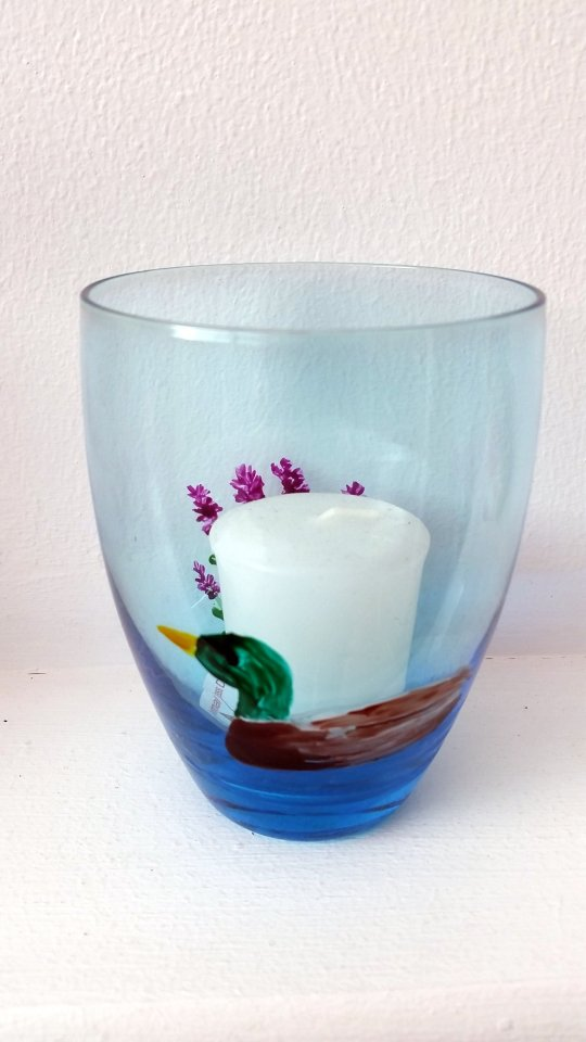 Glass candle holder with blue tinge and a duck painting