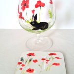 Brandy glass and coaster set with poppies and a black rabbit