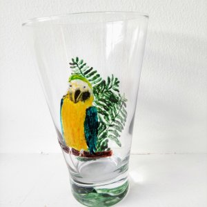 Glass painting of a Parrot and a fern on a glass