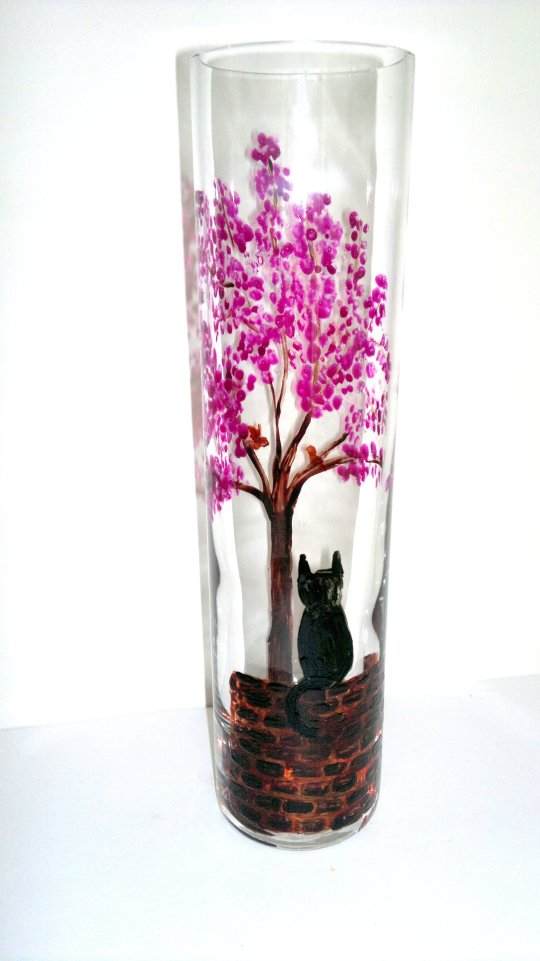 Bud vase glass painting with a black cat on a wall watching a bird in a blossom tree