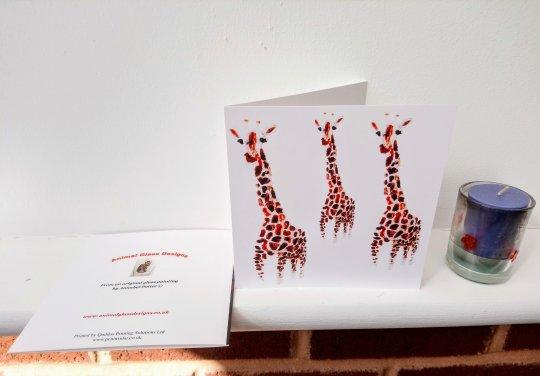 Wildlife greeting ard with three giraffe