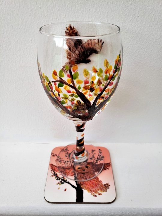 Wine Glass original glass painting and Coaster set with an owl in flight and an Autumn tree