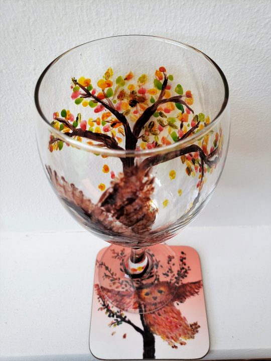 Owl glass amd coaster set with a tree with Autumn leaves, photographed from above