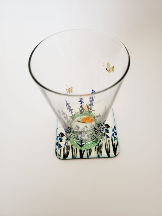 Glass and caoster set with bluebells and butterfly