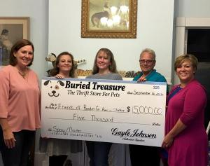 --Submitted Photo. Hardin County Pet Protection's Pet Pros recently presented the Friends of Hardin County Animal Shelter with a $5,000 check for spaying and neutering efforts.