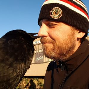 Canuck the crow and best friend Shawn Bergman.