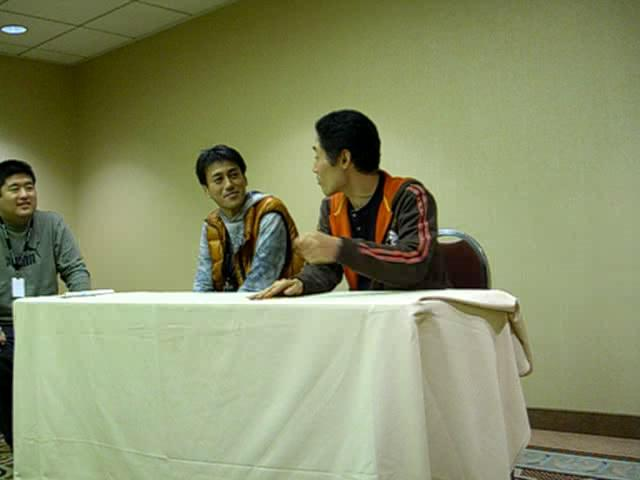 L to R: translator, Umehara, Tanaka