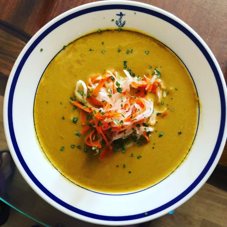 Carrot soup with pickled carrot and daikon salad.