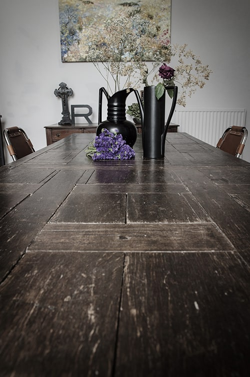 Image above: We can only imagine the plotting and mischievous going-ons that could take place around this weathered table. Purple, black and cocoa are nice ways to subtly nod to the bewitching season.