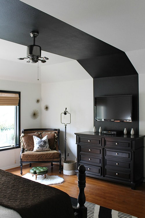 Image above: Follow the black to…more black in a bedroom full of rich contrast.