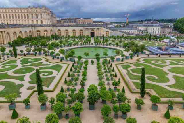aerial view of Famous palace Versailles with beautiful gardens and fountains in France