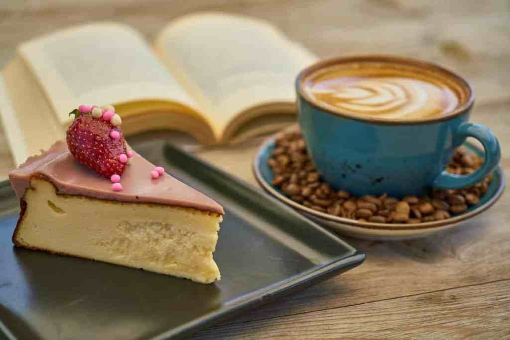 coffee and cake near book