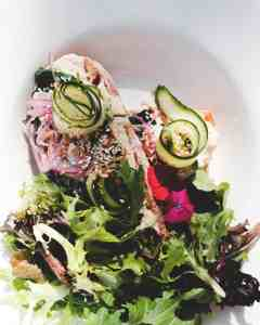 delicious healthy mix leaves salad with red onions and cucumber