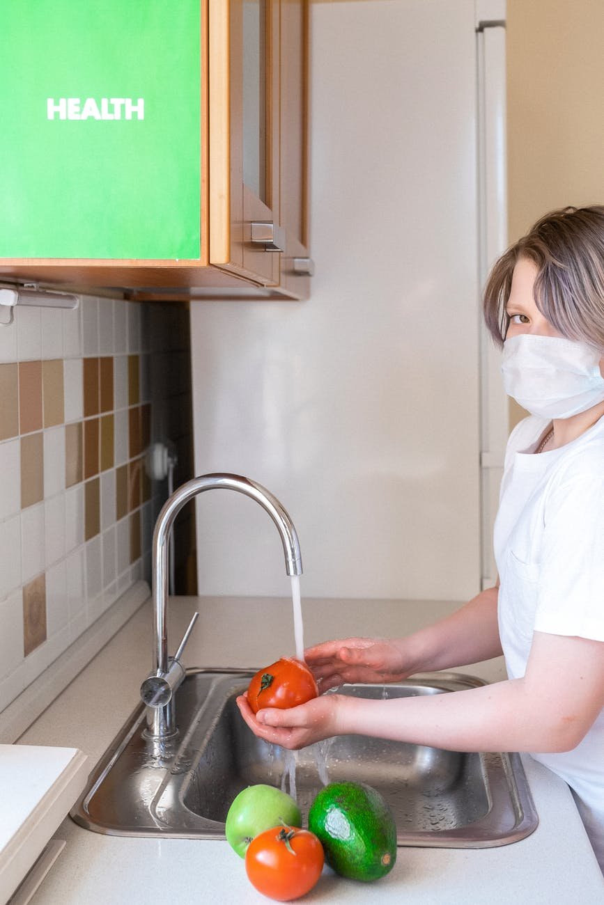 person washing food for healthcare