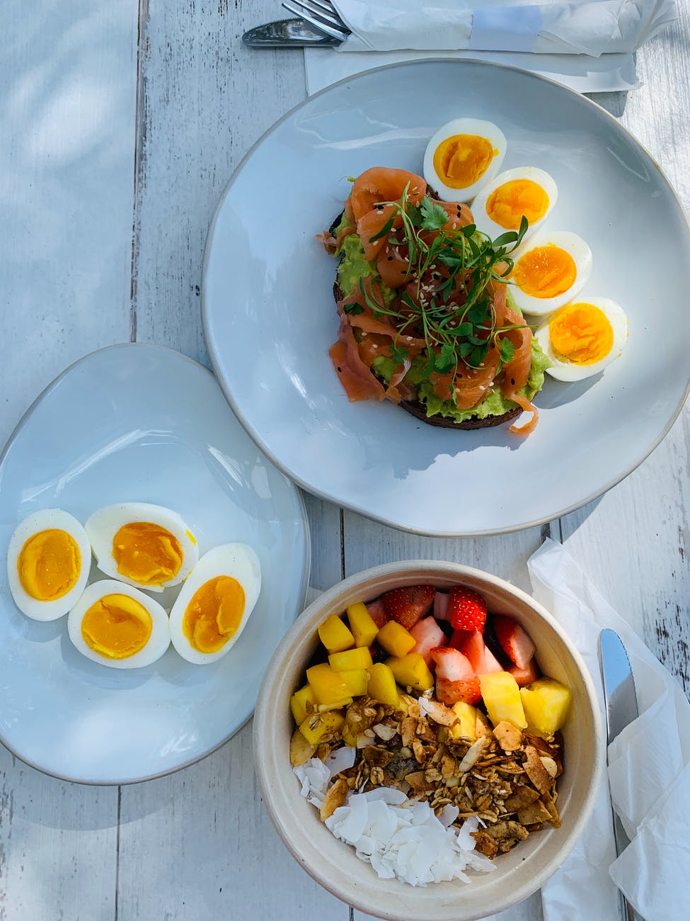 healthy breakfast with boiled eggs sandwich and sliced fruits