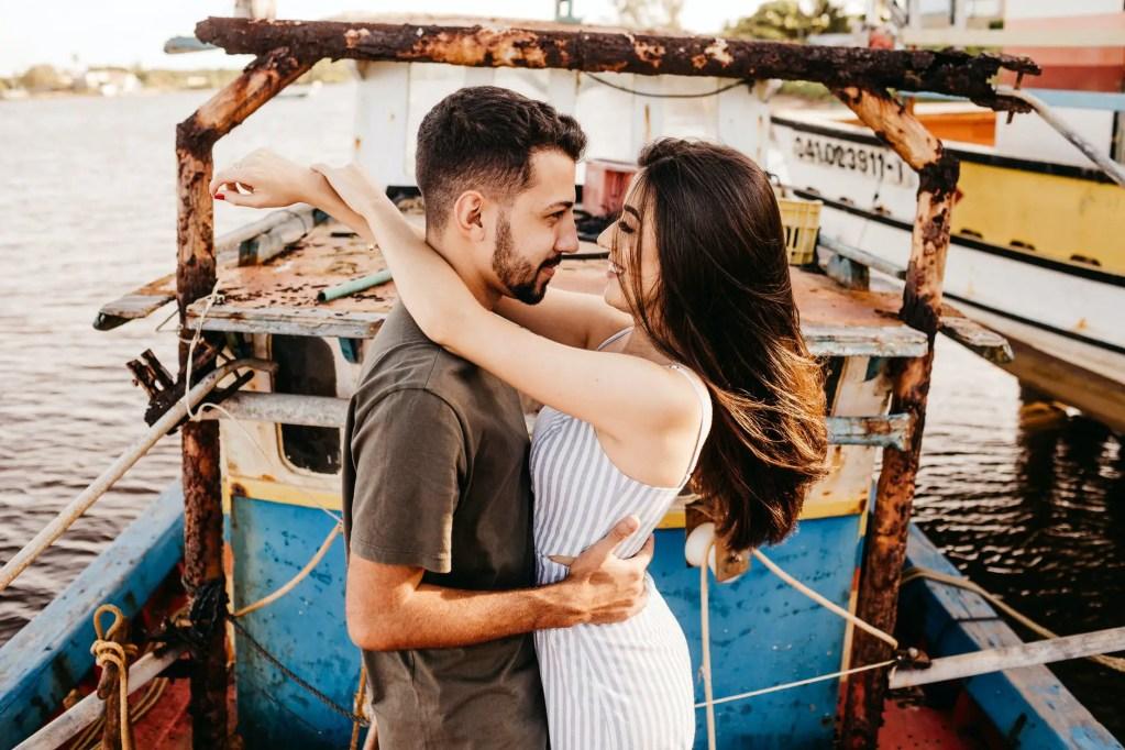 joyful couple hugging on weathered boat