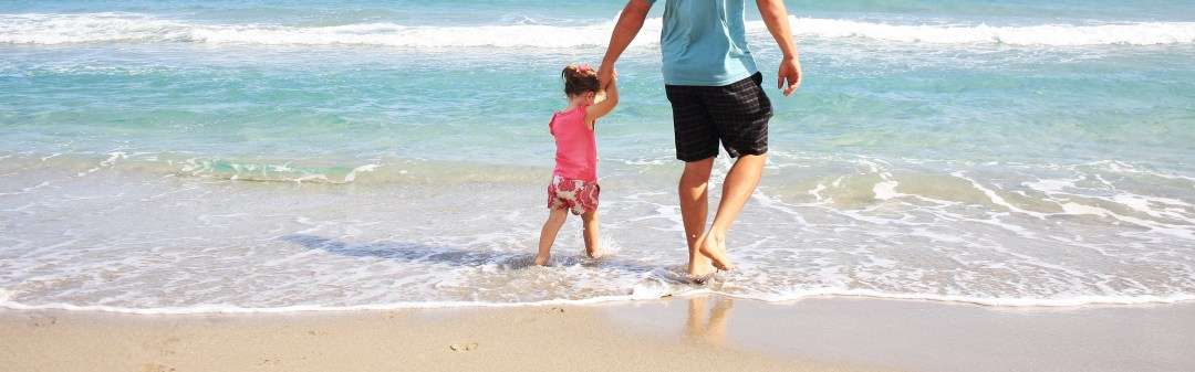 father daughter beach sea - Family Travel
