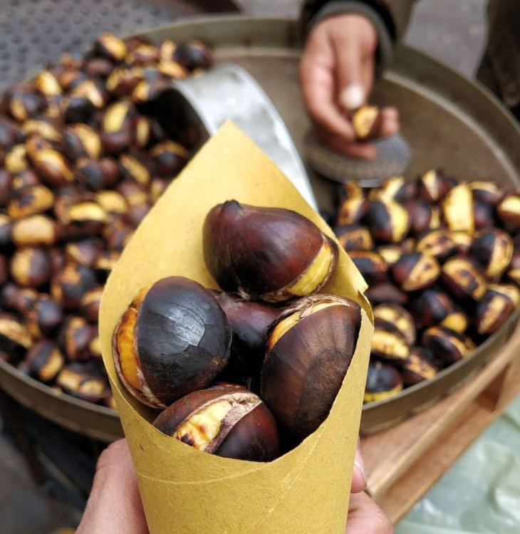 Image of a street vendor roasting chestnuts.
