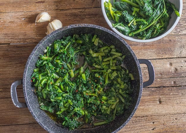 italian broccoli rabe pasta, cooked rabe in a pan