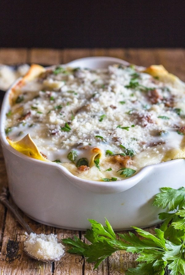white sauce lasagna baked in a white dish