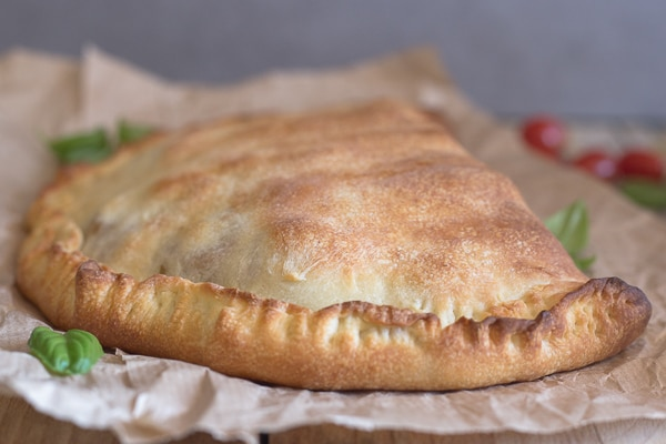 calzone baked on brown paper