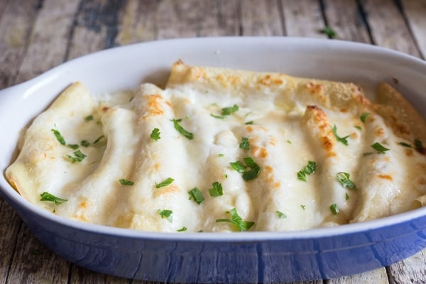 crepe cannelloni in a blue pan baked