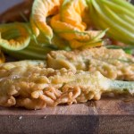 zucchini flowers on a board
