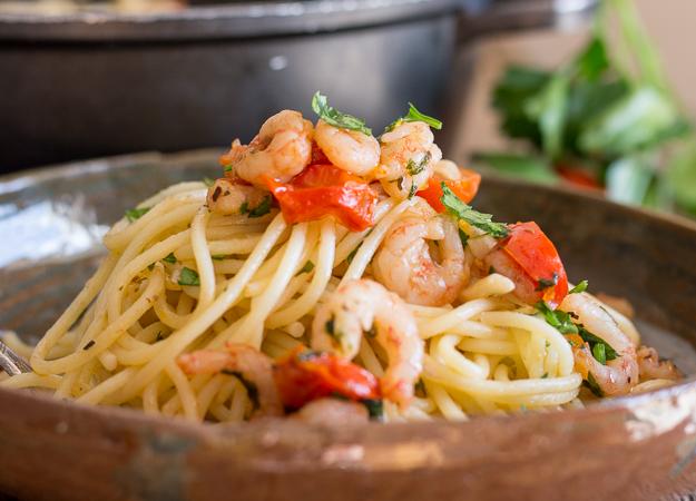 shrimp and tomato pasta in a dish