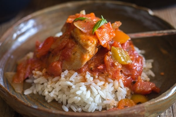 up close chicken cacciatore in a plate over rice
