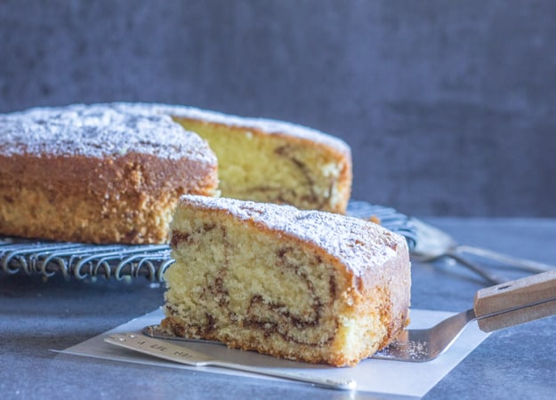a slice cut from the simple easy cinnamon cake
