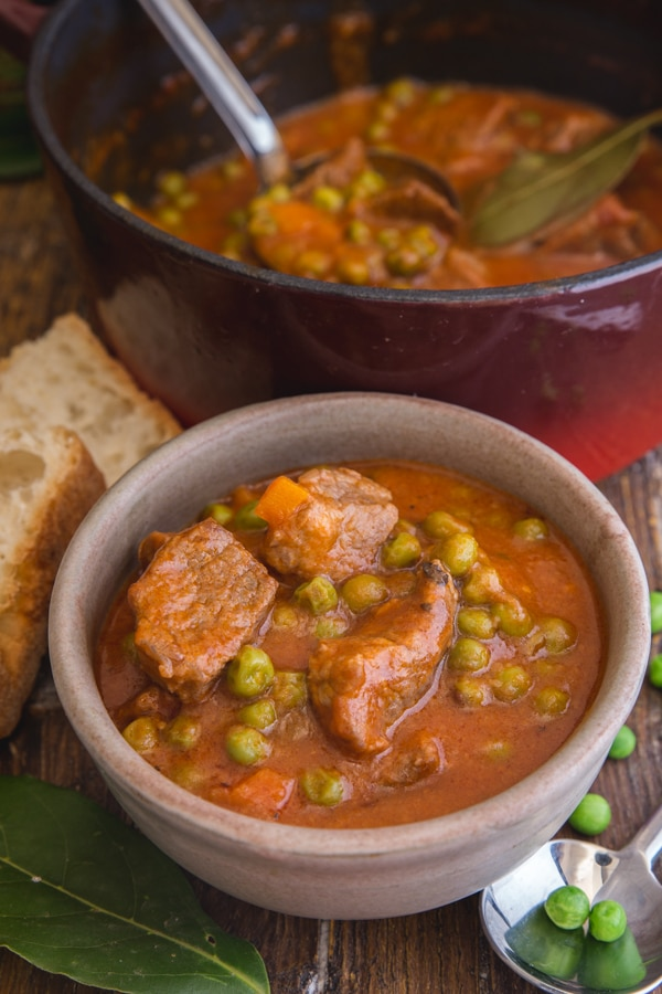 beef stew in a bowl and in a red pot