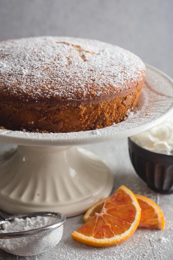 coconut orange cake on a white stand