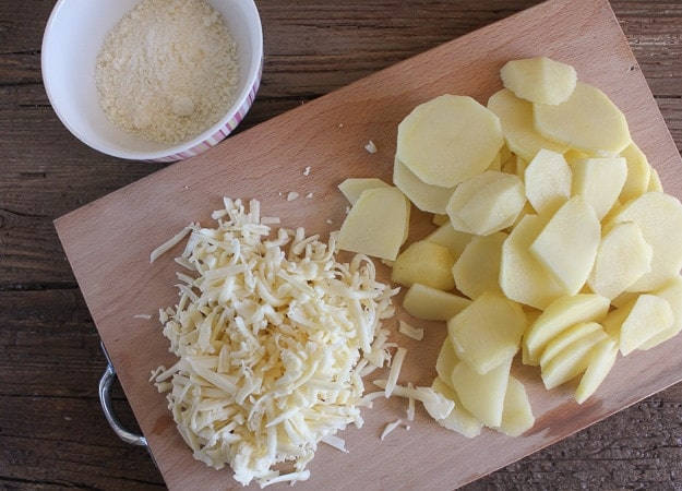 shredded cheese, parmesan and sliced potatoes for scalloped potato recipe