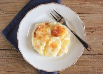 a serving of ceamy cheesy scalloped potatoes
