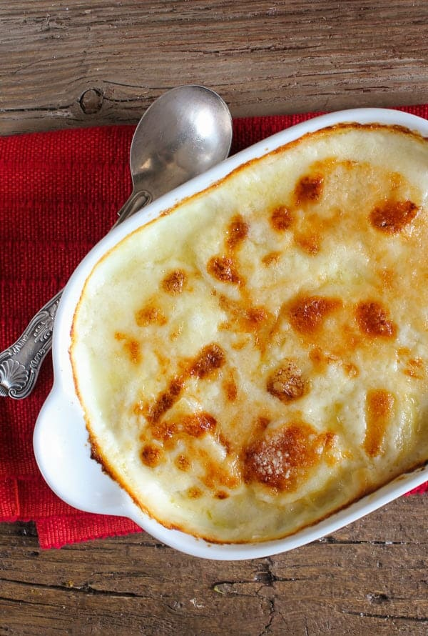 scalloped potatoes baked in a white pan