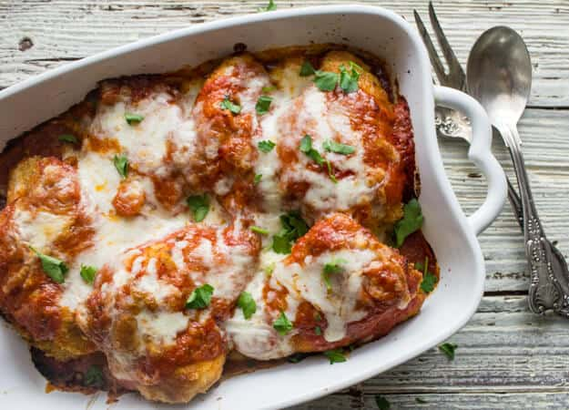 Baked Chicken Parmigiano, an easy, delicious baked chicken casserole recipe. A perfect comfort food dinner for family or guests. The best!